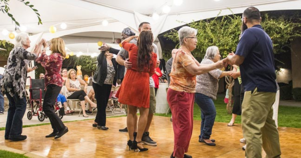 People dancing on a dance floor.